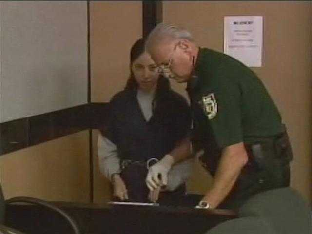 June 2011: Dalia Dippolito is fingerprinted as she enters the courtroom for her sentencing.