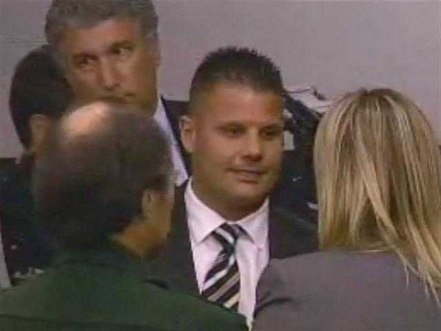 May 2011: Mike Dippolito exchanges pleasantries with one of the prosecutors in his wife's trial after learning the verdict.