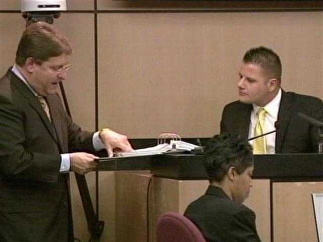 April 2011: Michael Dippolito looks at evidence with defense attorney Michael Salnick.