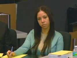 April 2011: Dalia Dippolito listens and takes notes as her estranged husband testifies against her in court.