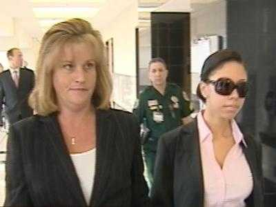 December 2009: Dalia Dippolito walks into court holding hands with one of her attorneys.