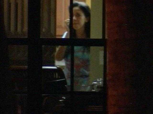 August 2009: Dalia Dippolito can be seen talking on the telephone through a window at her mother's house after her release from jail.