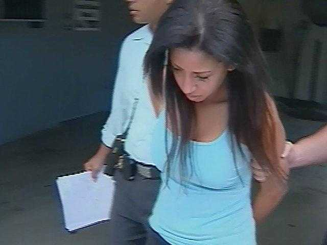 August 2009: Dalia Dippolito is carried away from the Boynton Beach Police Department in handcuffs.