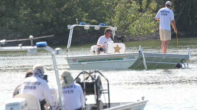 Broward Sheriff's Office divers search Crystal Lake for a man presumed drowned.