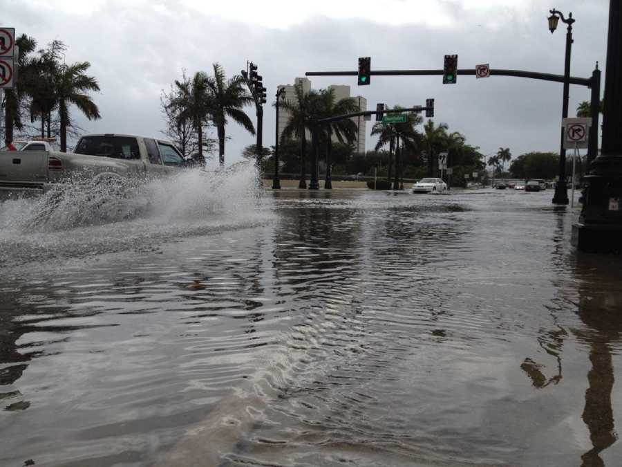 Drivers approaching Okeechobee Boulevard proceed with caution in the flood waters.