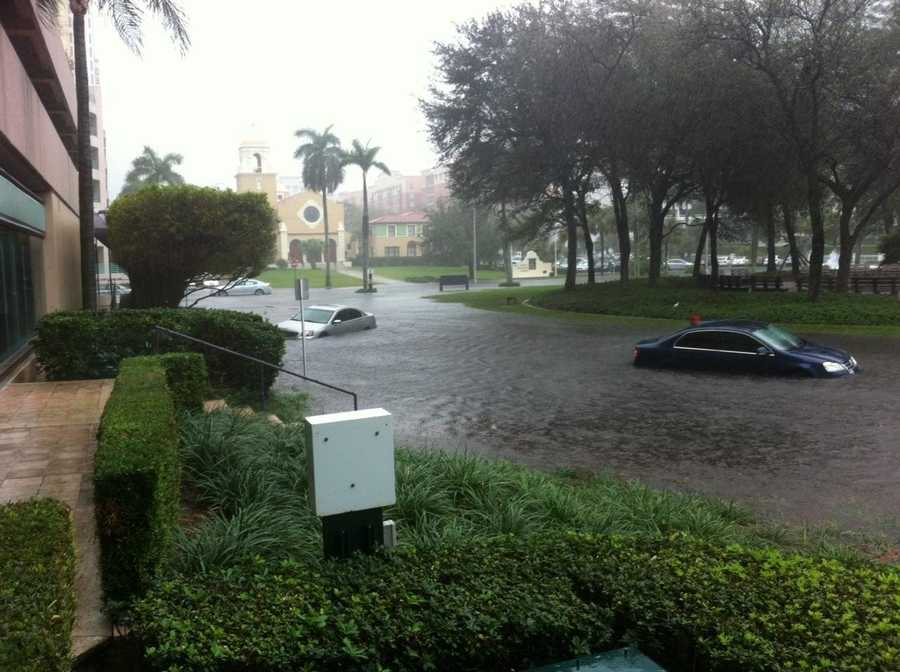 Several cars are stuck in the water behind Phillips Point in downtown West Palm Beach. A man who works at Phillips Point says it's the worst he's seen it.