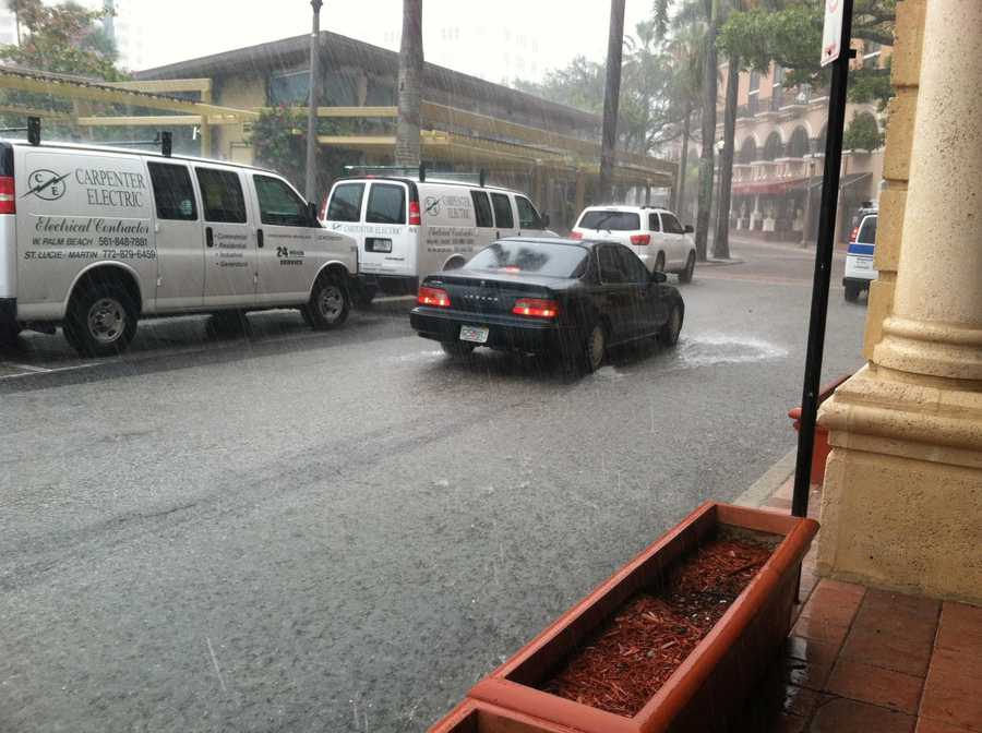 Flood waters invade the corner of Clematis Street and Flagler Drive.