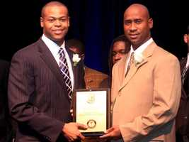 Lou Groza Collegiate Place-Kicking Award banquet master of ceremonies Jason Pugh (left) poses with first-year Glades Central football coach Roosevelt Blackmon, whose Raiders were honored as the 2011 team of the year.