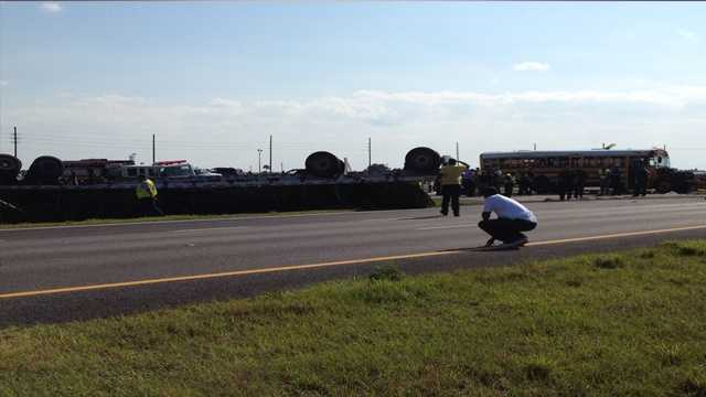 A school bus collided with a semi-truck in St. Lucie County late Monday afternoon. (Ari Hait/WPBF)