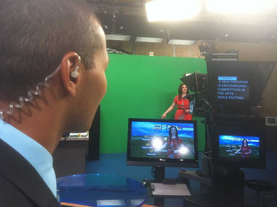 Matt on set during a run-through, while Hayley does weather.