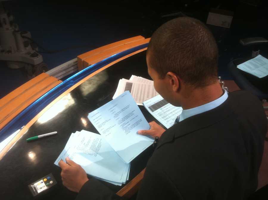 Matt reads scripts at the anchor desk.
