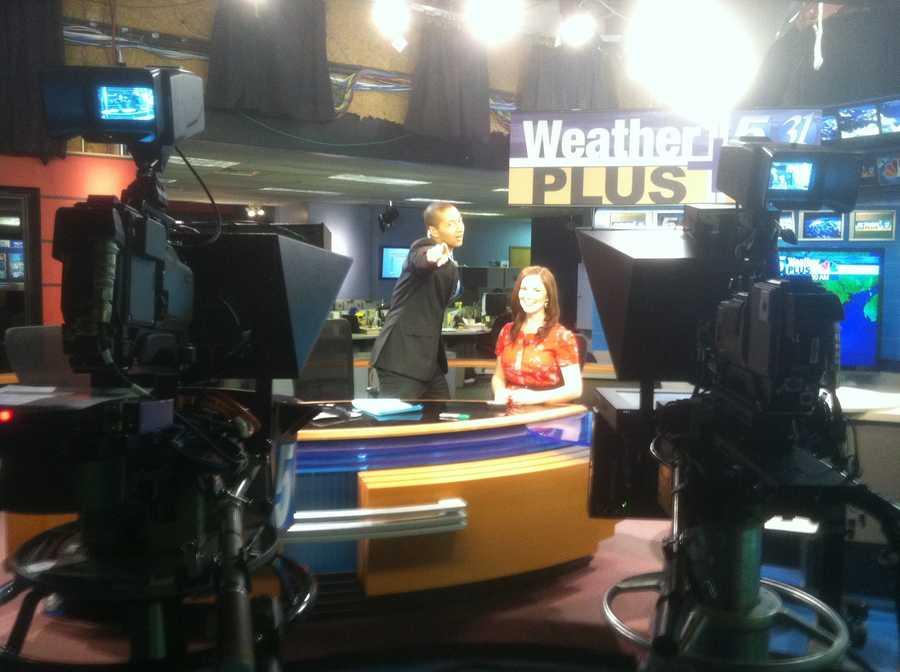 Matt and Hayley goofing around on the set.