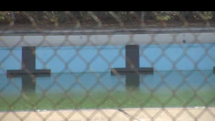 St. Albans police say a dead body was found in a local pool Monday afternoon and they aren't sure how it got there.