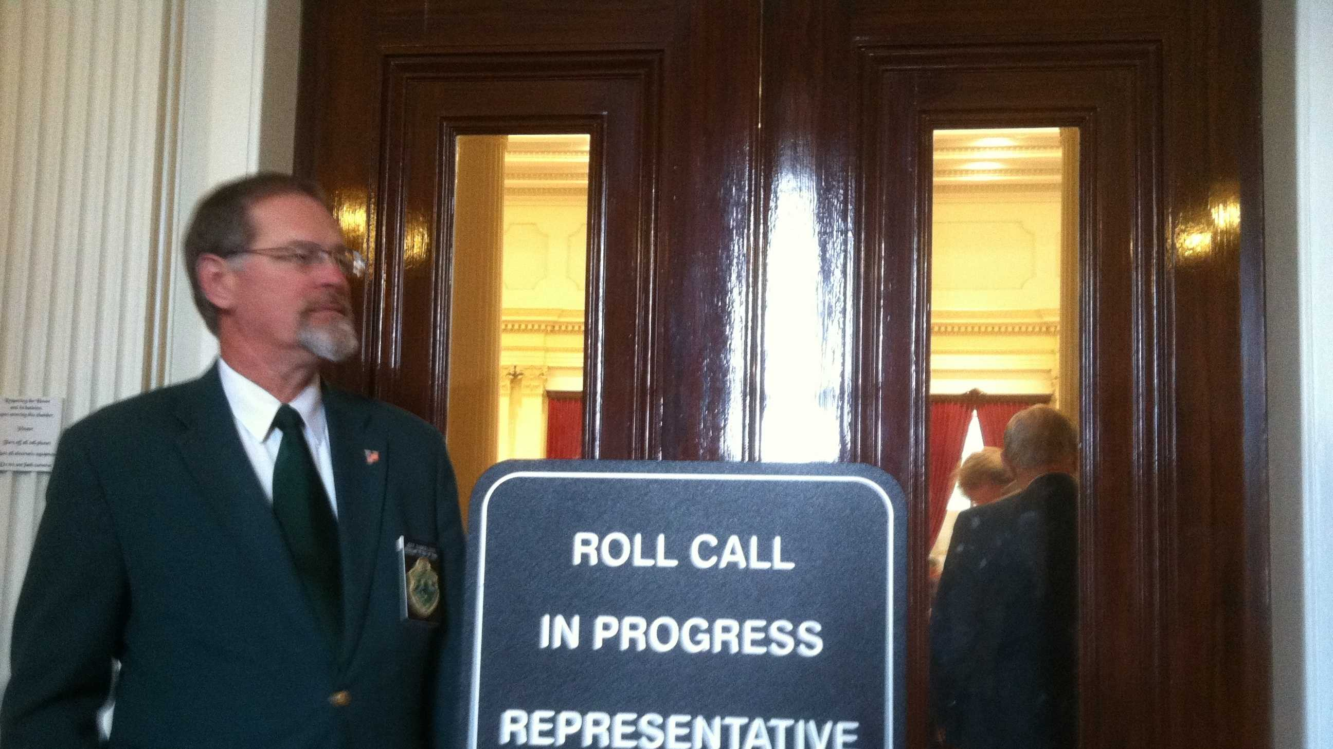 Doorkeepers monitor access to the Vt. House chamber during one of Tuesday's roll call votes.