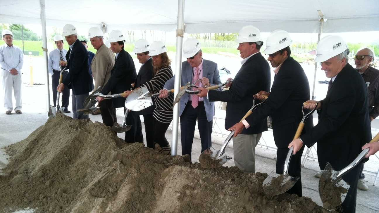 Peerless Clothing CEO Alvin Segal, center, joins local and state leaders for ceremonial groundbreaking for its latest expansion at the St. Al&#x3B;bans town industrial park.