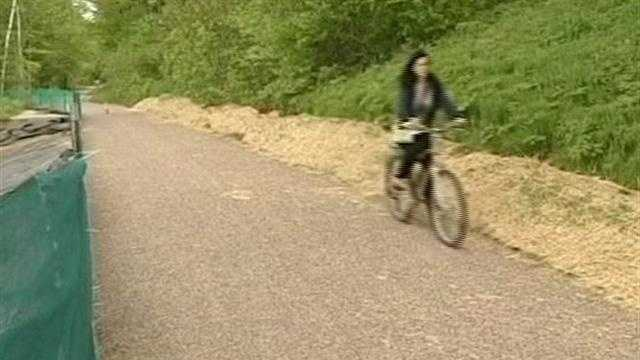 Officials in Burlington have pledged to complete repairs to the popular bike path by the end of the year.