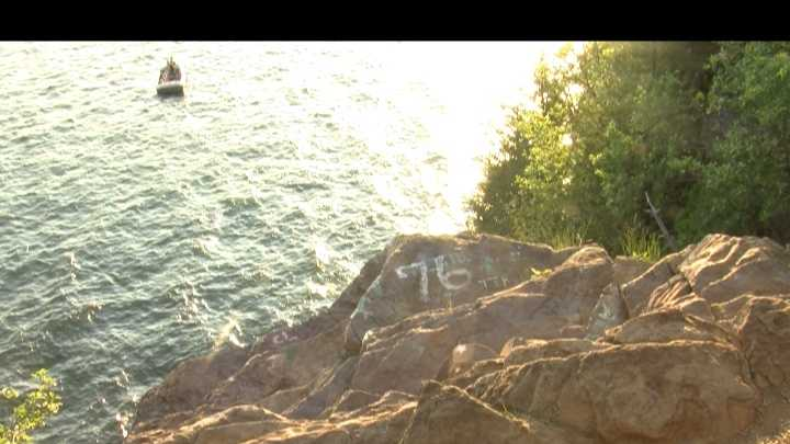 A man is hurt after jumping off a 70 foot cliff and diving into the water below on Monday.