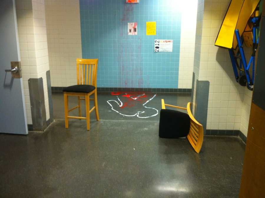 The outline of a body on the floor of the school was done in white paint. The blood splatter, which covered the floor, wall and ceiling was done in red paint.