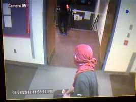 Stephen Menard , wearing cloth wrapped around his head, is caught on surveillance  inside Milton Middle/High School.