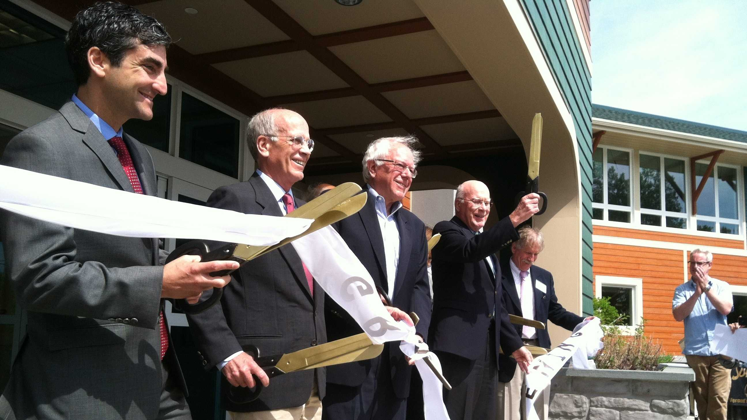 Vermont's congressional delegation cuts a ceremonial ribbon marking completion of an $11 million expansion of the Community Health Center of Burlington.