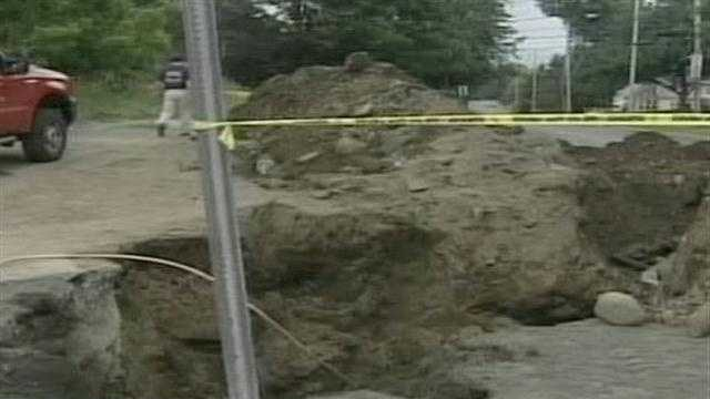 Two workers were buried up to their waists when the trench they were digging collapsed Tuesday morning.