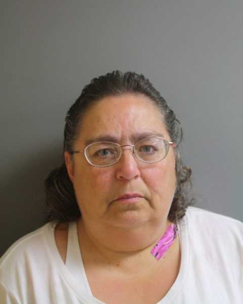 Ann Wells, 53, of Milton, was arrested for purchasing and using the card that was sold to her by her son, Steven Wells.