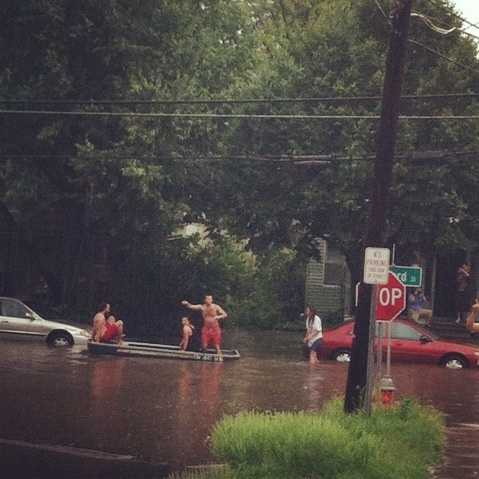 Residents canoe along North Willard Street in Burlington after a torrential Fourth of July storm.