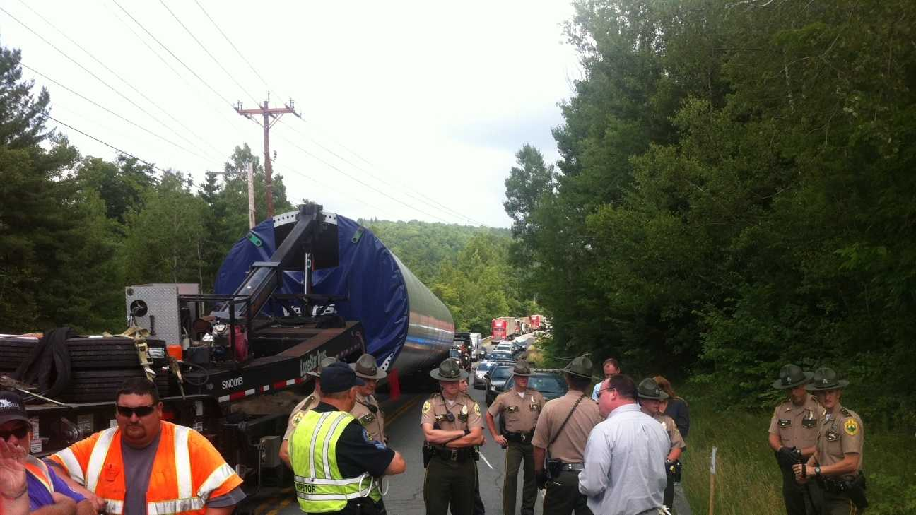 A spokeswoman for a Vermont utility says protesters have stopped traffic on Route 100 while officials try to deliver components to be used as part of the Lowell Mountain wind project.
