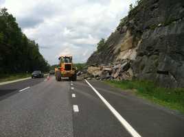 Rockslide clean up begins.