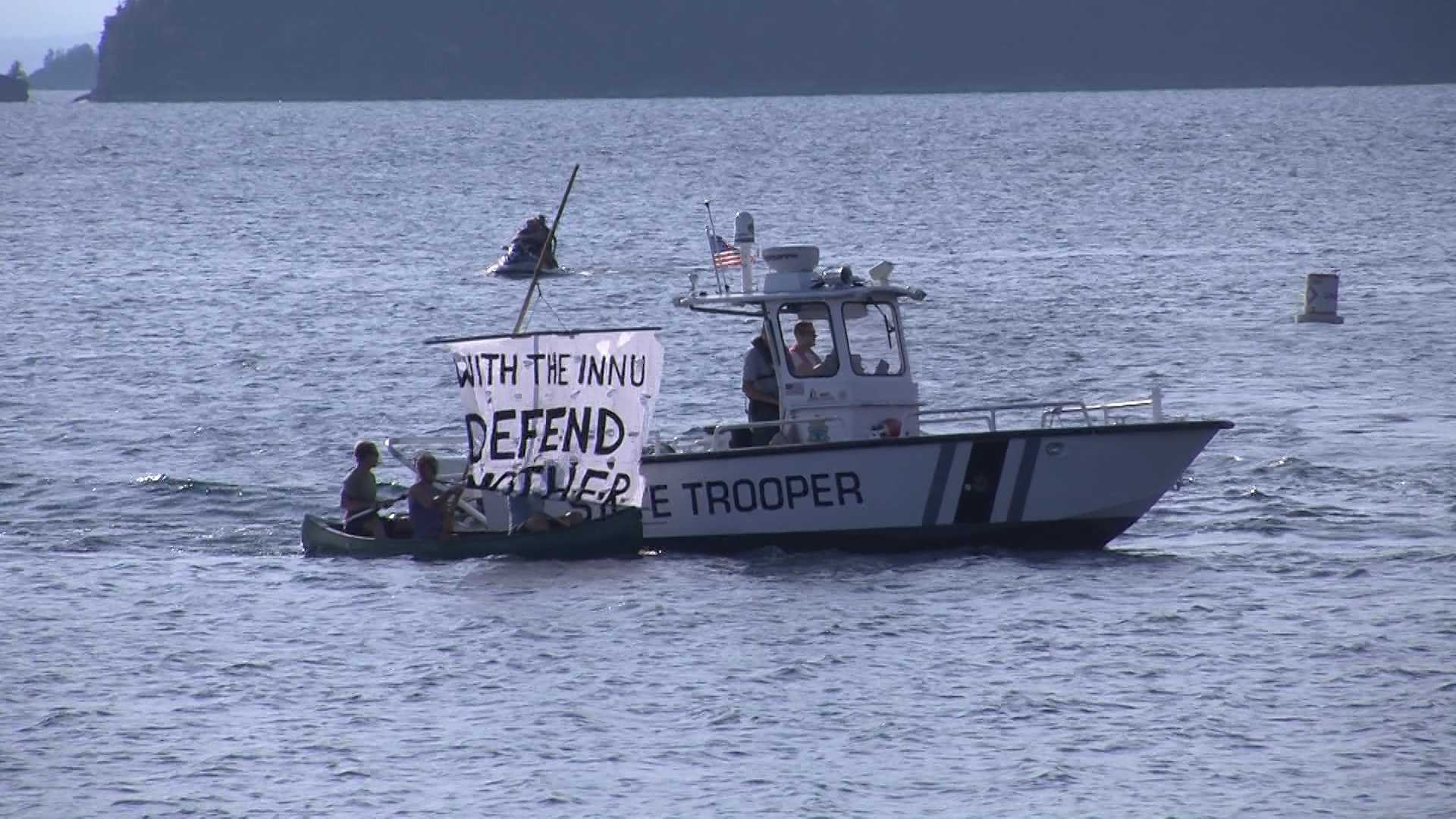 073012 Summit protesters take to land and sea