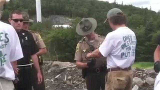 Cheers erupt as activists are arrested during a protest at Lowell Mountain.
