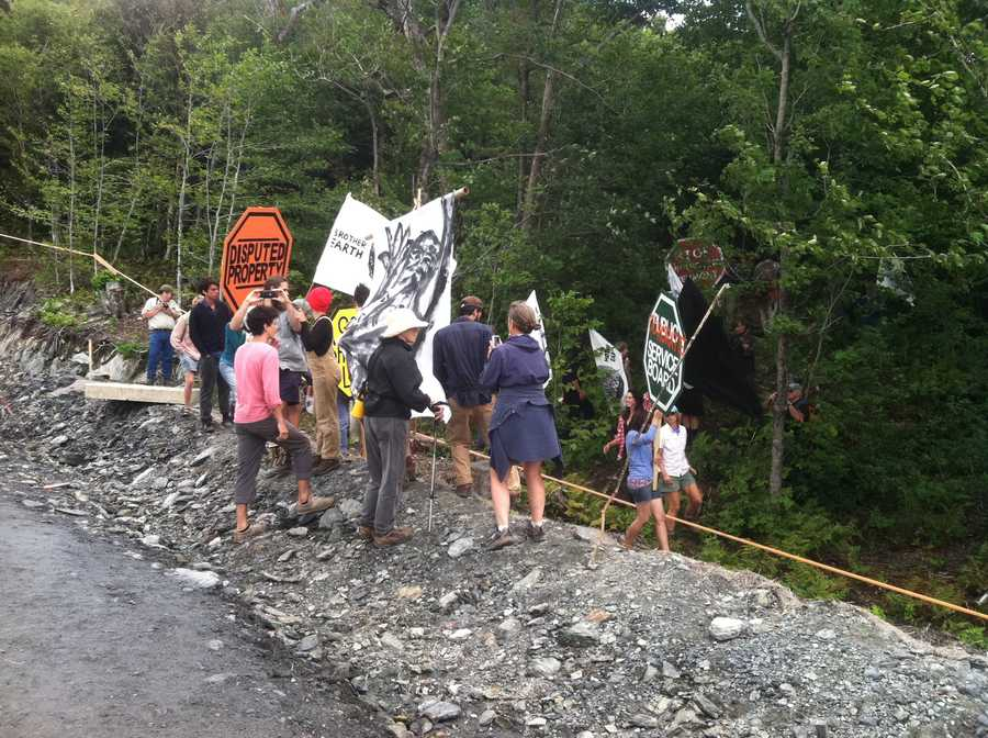 Activist, who call themselves the Mountain Occupiers, line the access road to the Lowell Mountain wind turbine construction site.