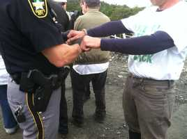 A Mountain Occupier is arrested Monday afternoon.