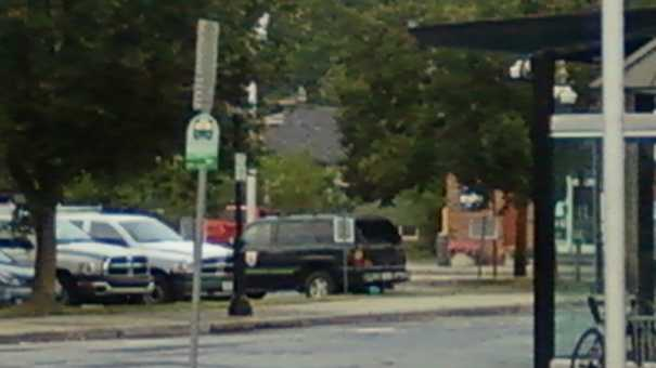 The green square behind the truck with cap is the suspicious package.