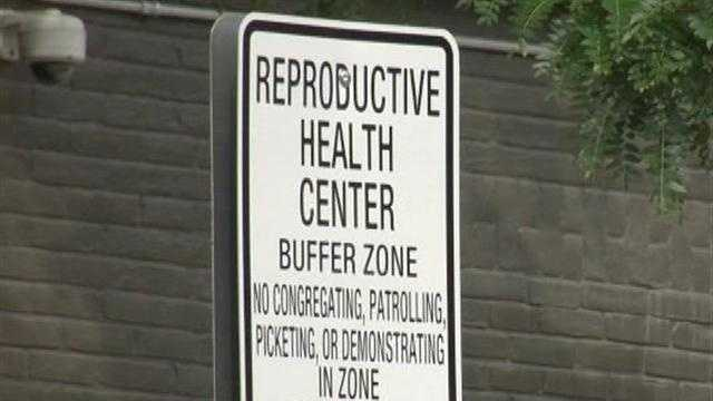 A new ordinance goes into effect in Burlington, pushing Planned Parenthood protesters back 35 feet from the door and parking lot at the center.