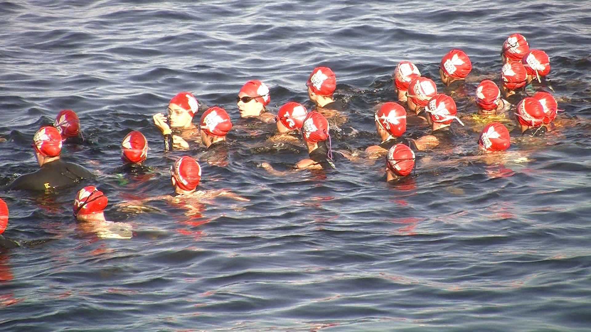 A group of women prepare for the 750-meter swim in Lake Champlain.
