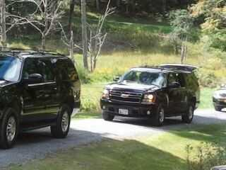 Republican presidential nominee Mitt Romney and top aides leave the front gate of the West Windsor, Vt. estate for a campaign stop in West Lebanon, N.H.