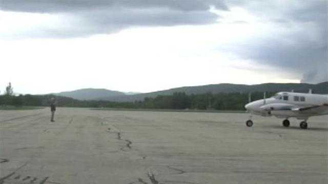 A plane from out-of-state lands at Rutland airport to be loaded with pesticides and spray thousands of acres of land for mosquitoes.