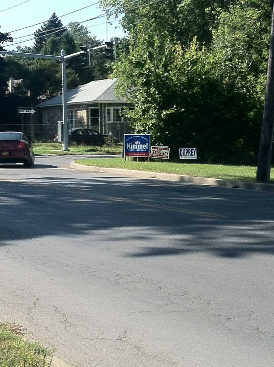 Signs for all three republican candidates line Oak and Boyton in Plattsburgh.