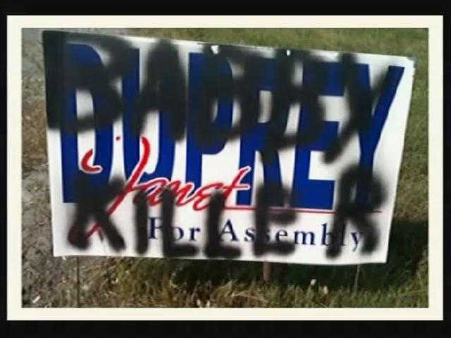 "Assemblywoman Janet Duprey, of New York, had ""baby killer"" spray painted on several campaign signs."