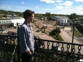 Jacob Allbee looks across route proposed for northern end of Champlain Parkway, which is also his front yard.