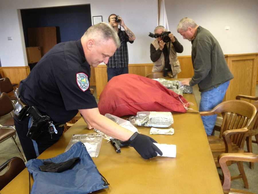 Authorities layout evidence collected in a drug bust in Malone.