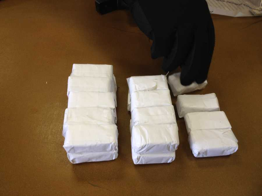 Heroin packets wrapped and concealed in paper.