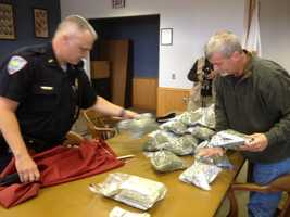 Money, pot laid out by authorities.