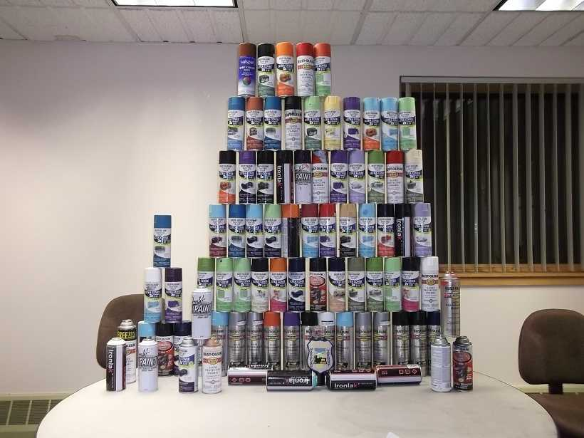 Nearly 90 spray paint cans were found in the trunk of Brian Dow's car. Dow is accused of graffitiing multiple overhead passes and boxcars.