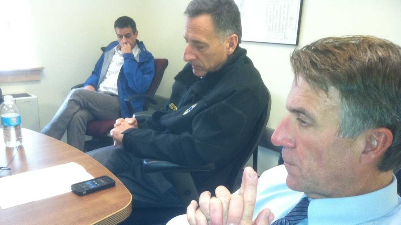 In Waterbury, Gov. Shumlin and Lt.Gov. Scott listen in on a conference call with President Obama and other northeast leaders concerning hurricane recovery efforts. Shumlin chief of staff Bill Lofy is in the background.