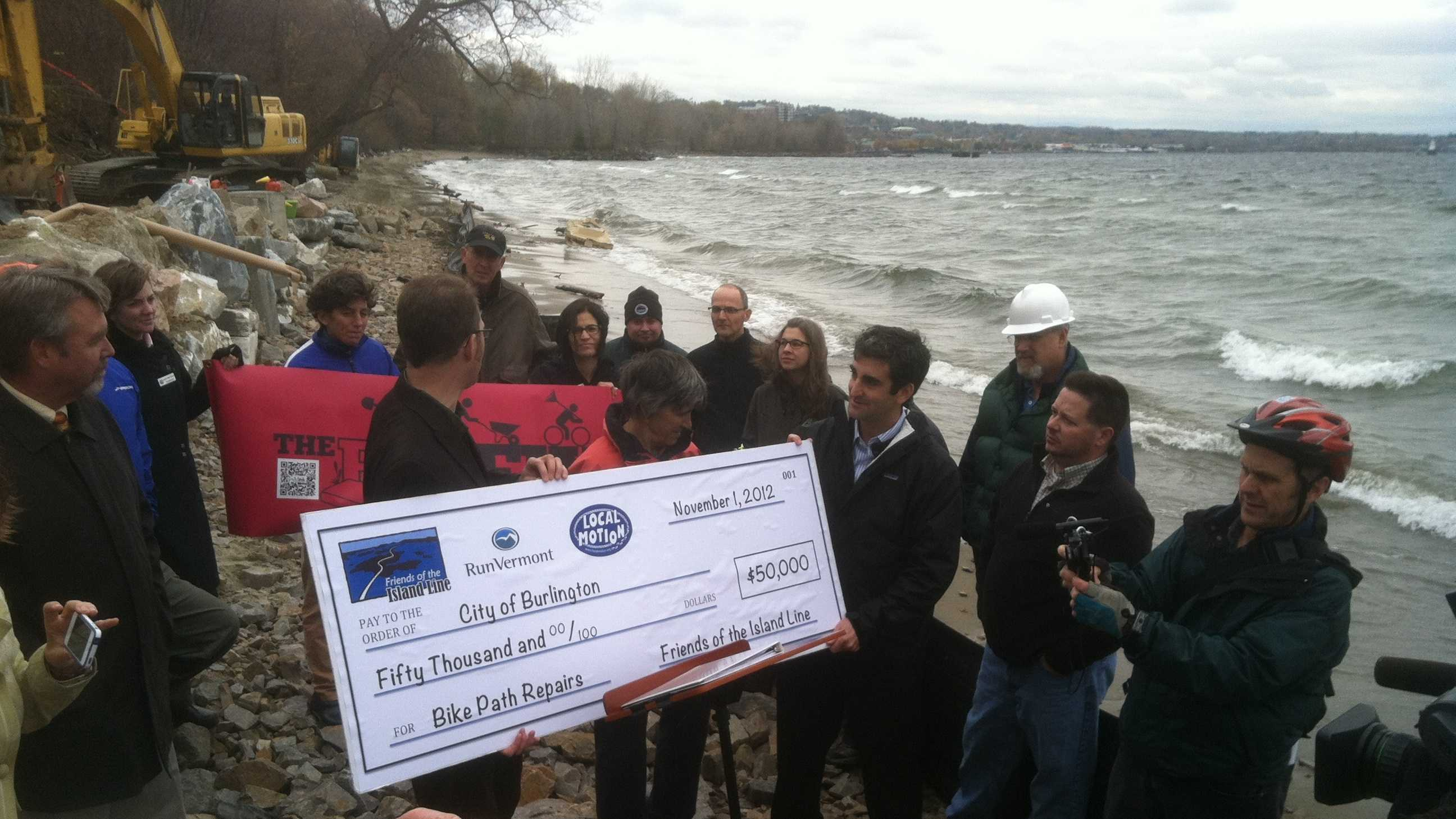 Mayor Weinberger holds news conference on the Lake Champlain shoreline urging support for three initiatives on Tuesday's ballot.