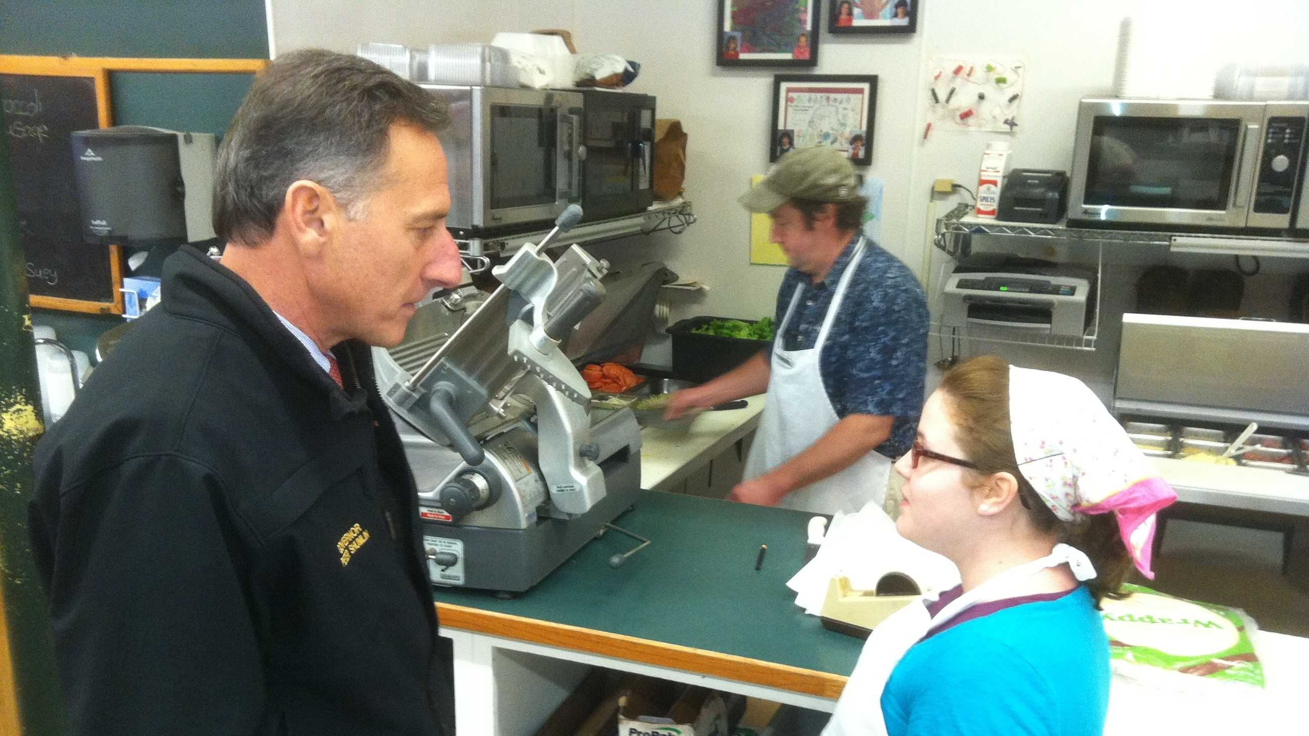 Gov. Peter Shumlin introduced himself to kitchen staff at Martone's Market in Essex Junction Monday.