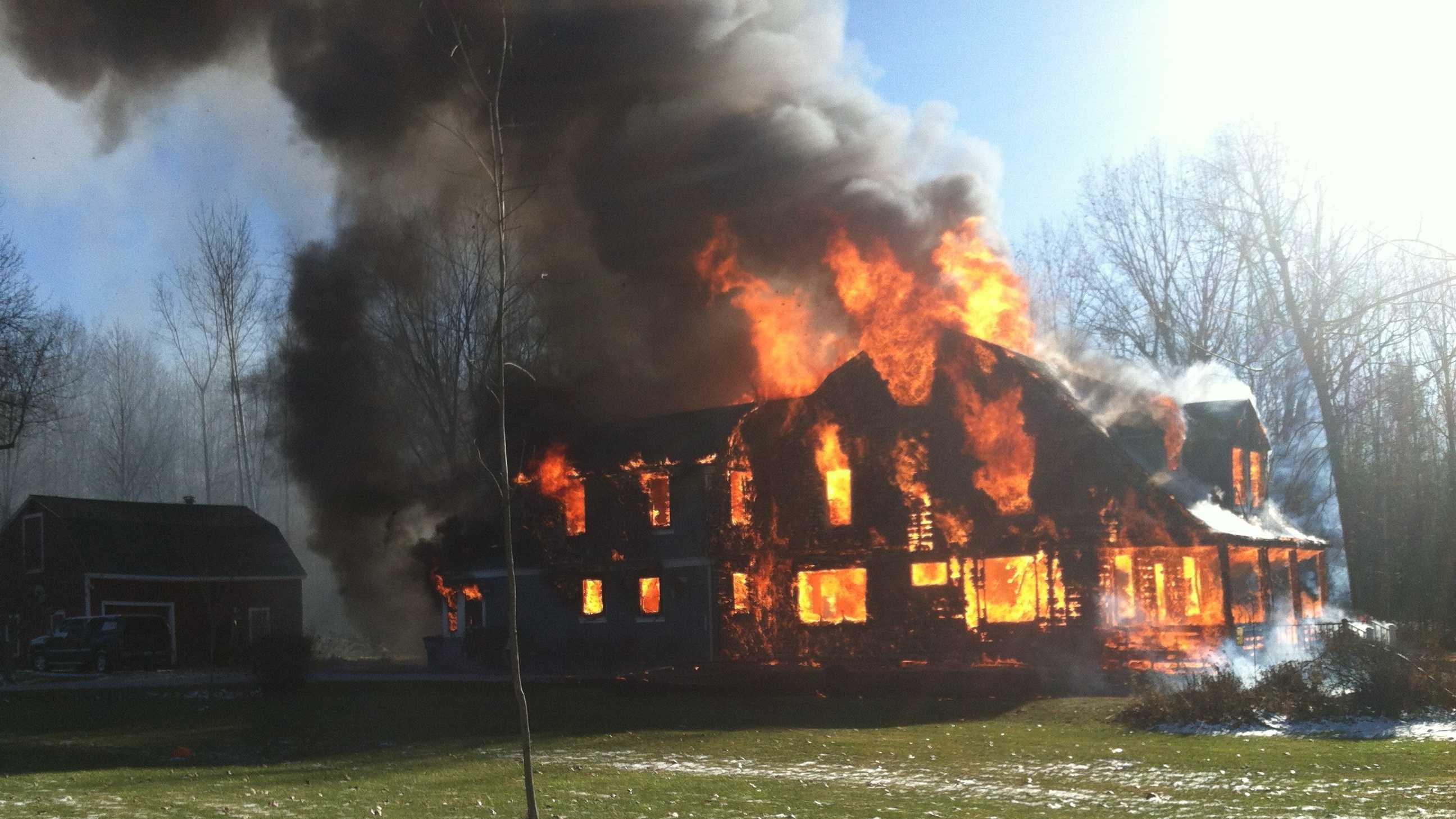 Fire engulfs an Isle La Motte home