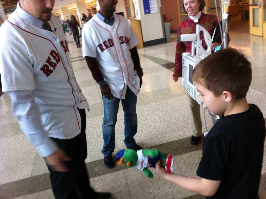 Fletcher Allen patient receives a stuffed Wally the Green Monster.